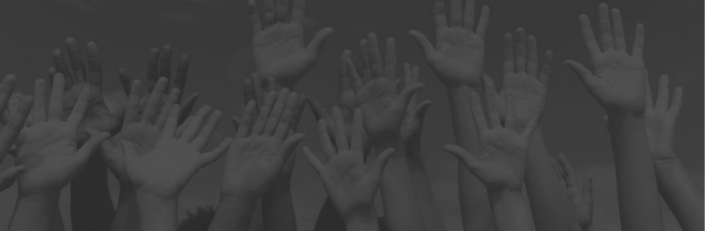 Image of several girls' hands raised in the air